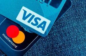 Visa e Mastercard são processadas por comerciantes por abuso de taxas